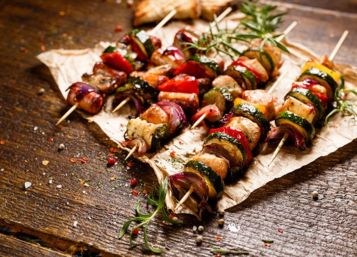 Vegetable kebabs on wooden board