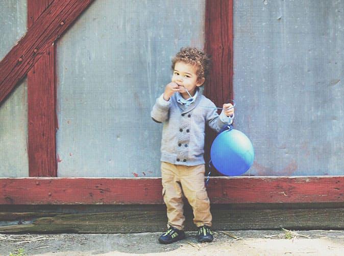 boy against bar with balloon 501