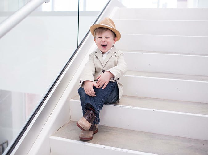 little boy cowboy hat on stairs 501