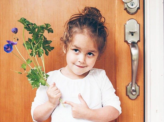 little girl holding flowers 501