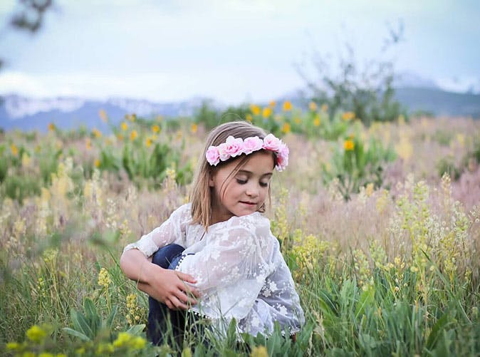 little girl in field flower crown 501