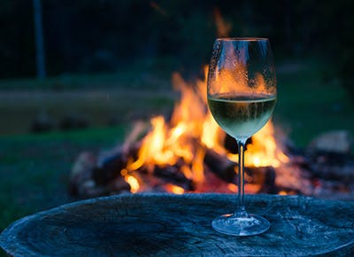 wine in front of fire 290