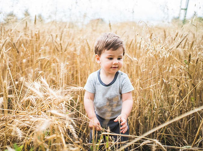 Baby boy playing in the field
