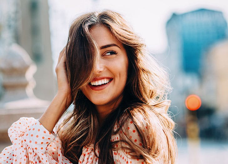 Confident smiling woman outside