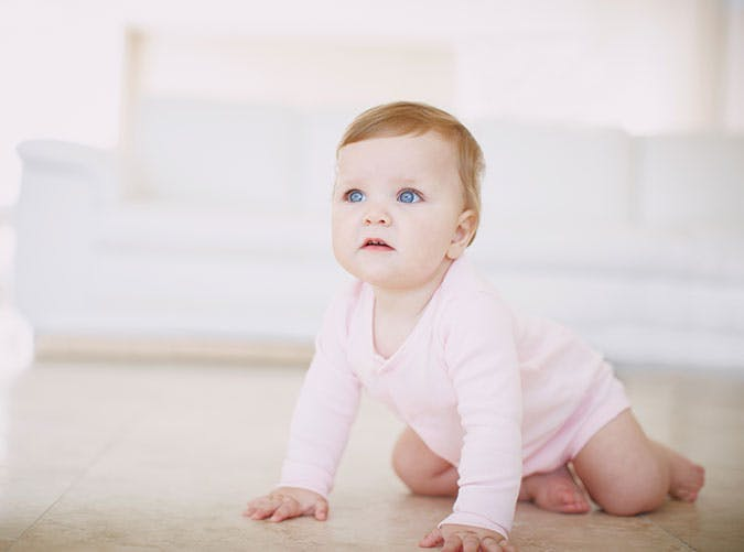 Cute baby girl crawling around on the floor