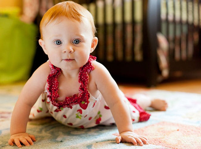 Cute baby girl crawling on the floor