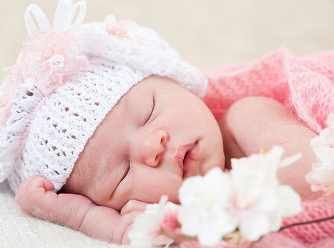 Cute baby girl sleeping in bed
