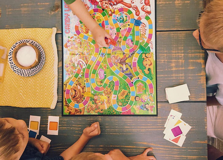 Group of kids playing candyland the board game