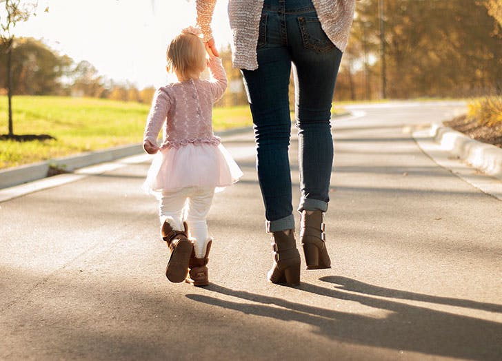 Mom walking with her daughter in the park