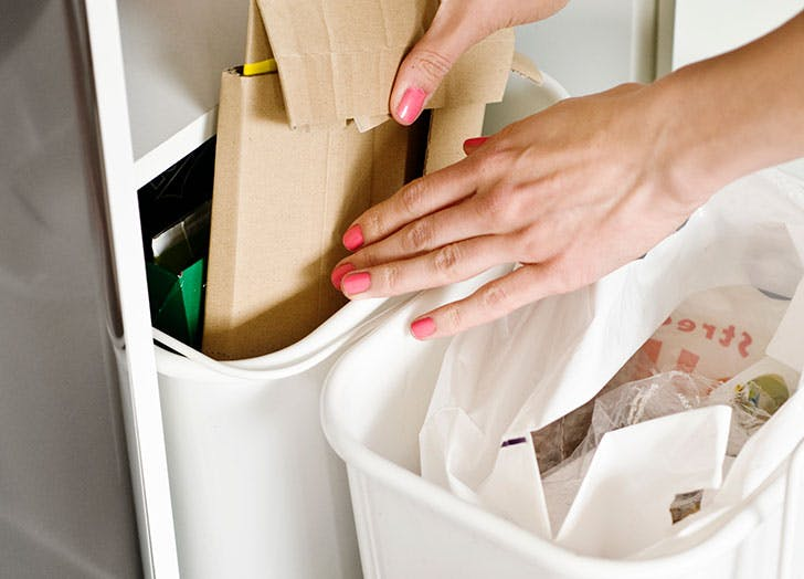 Woman organizing trash