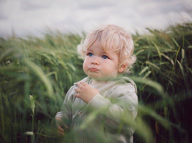 cute blond boy outside SLIDE