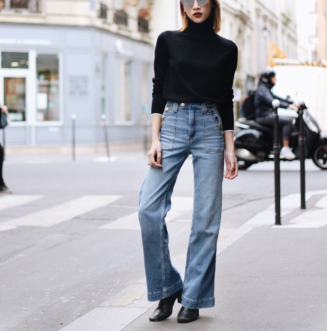 flred jeans and cropped tucked sweater