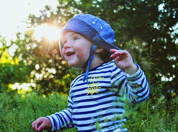 happy boy in hat outdoors 501
