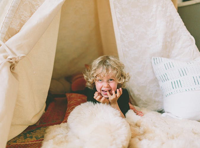 kid playing in tent SLIDE