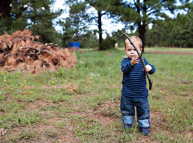 toddler boy holding stick 501