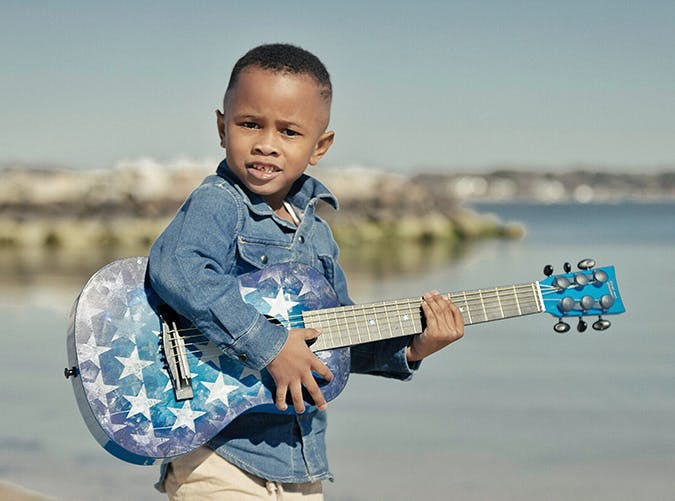young boy playing guitar 501