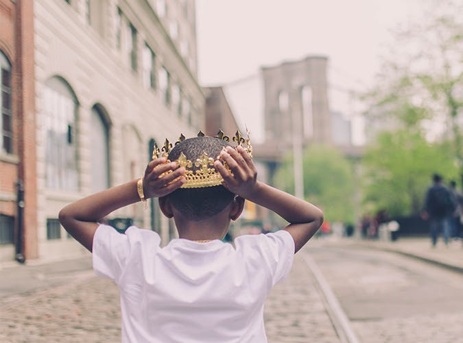 young boy wearing crown 501