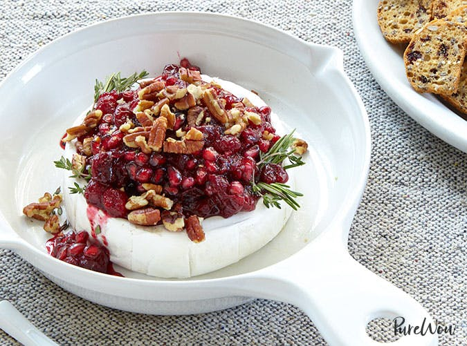 Baked brie with pomegranate and cranberry sauce