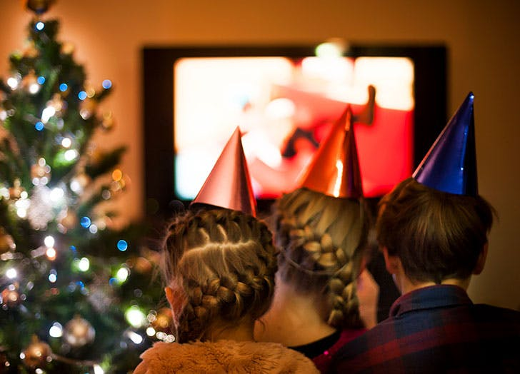 Children Watching TV on a Christmas Eve