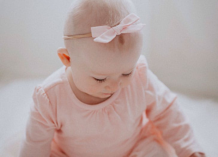 Cute Spanish baby girl in pink