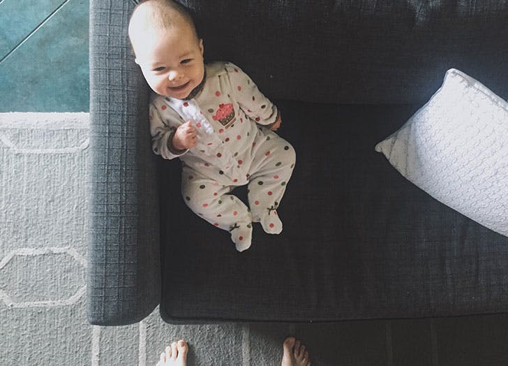 Cute baby sitting in sofa