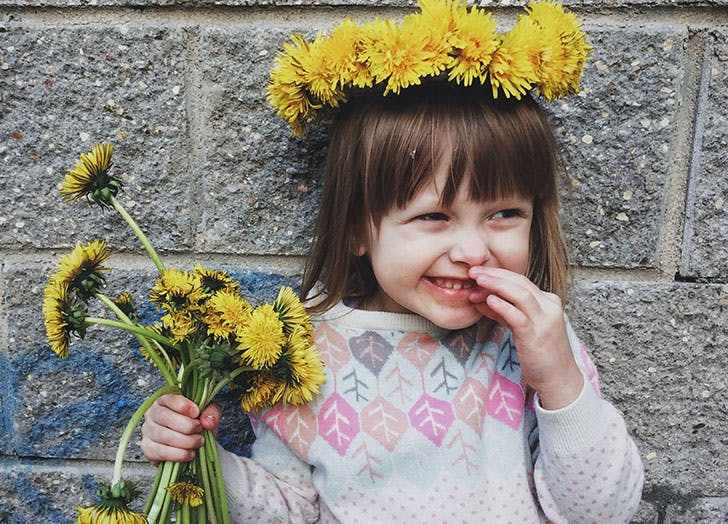 Cute little girl with yellow flowers in her hair