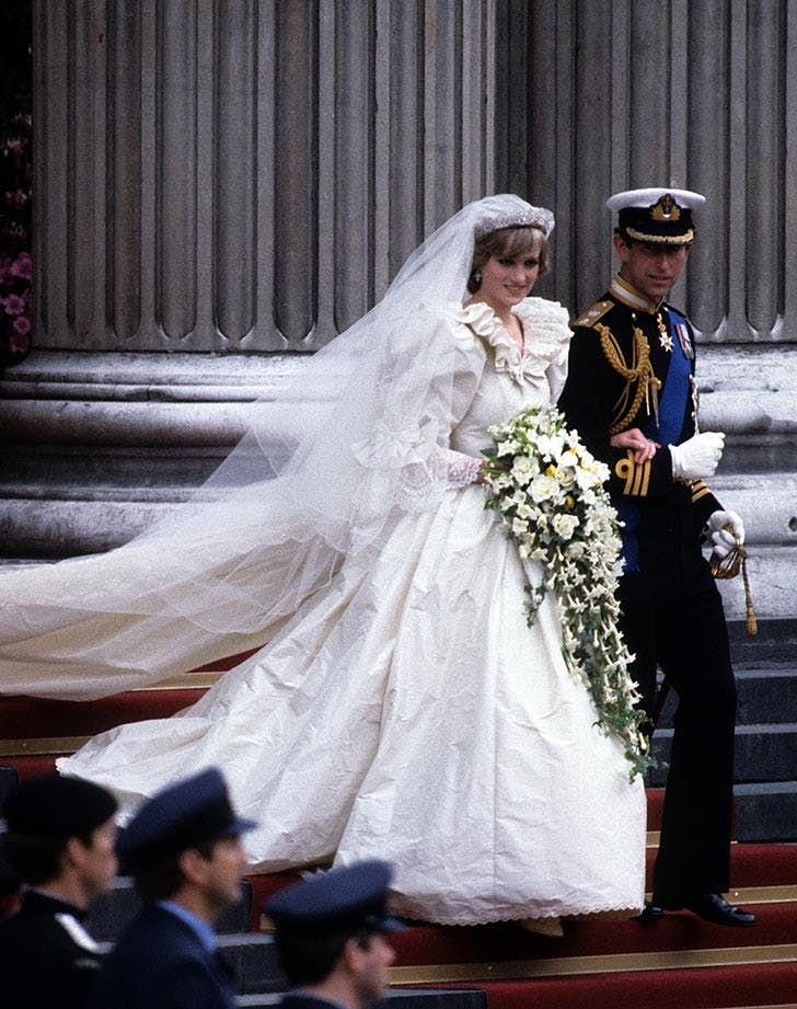 Diana  Princess of Wales  wearing an Emanuel wedding dress  leaves St. Paul s Cathedral with Prince Charles