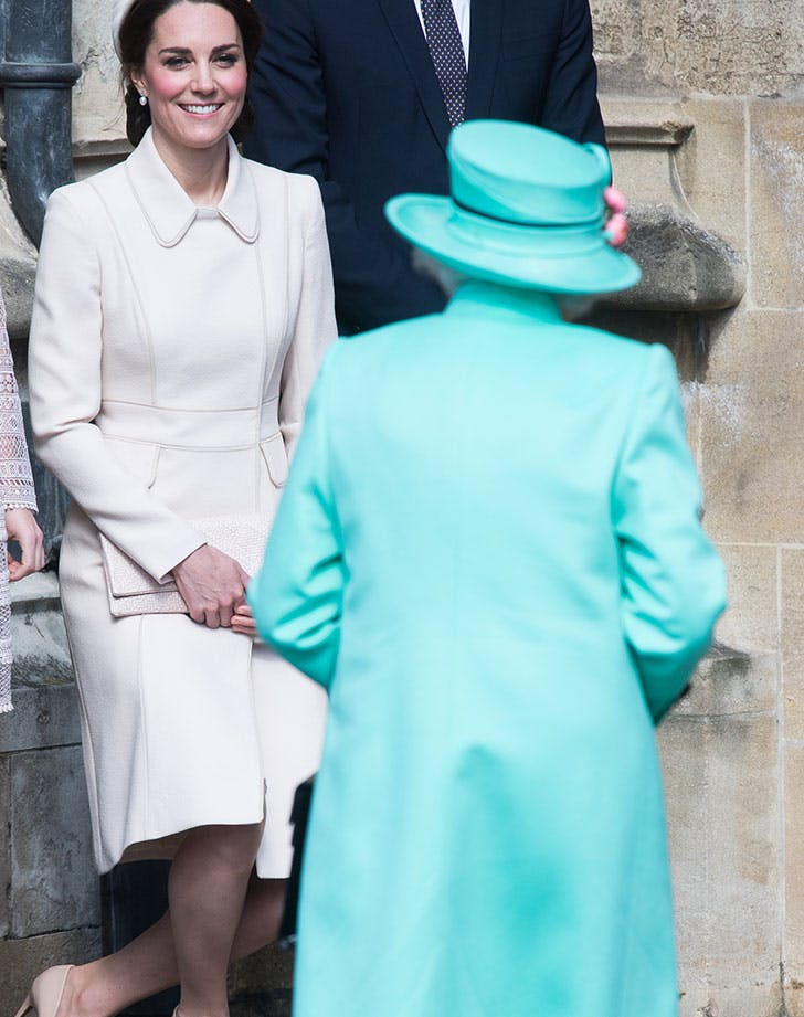 Duchess of Cambridge performs a curtsy to Queen Elizabeth II