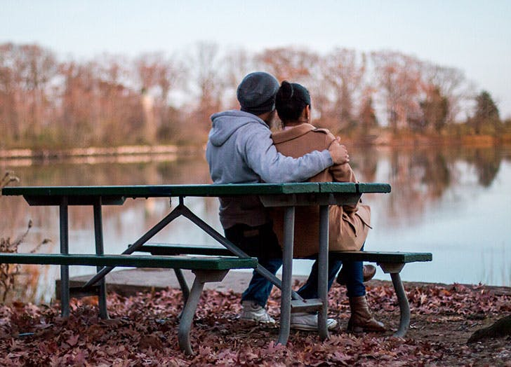 Long term couple sitting on bench together