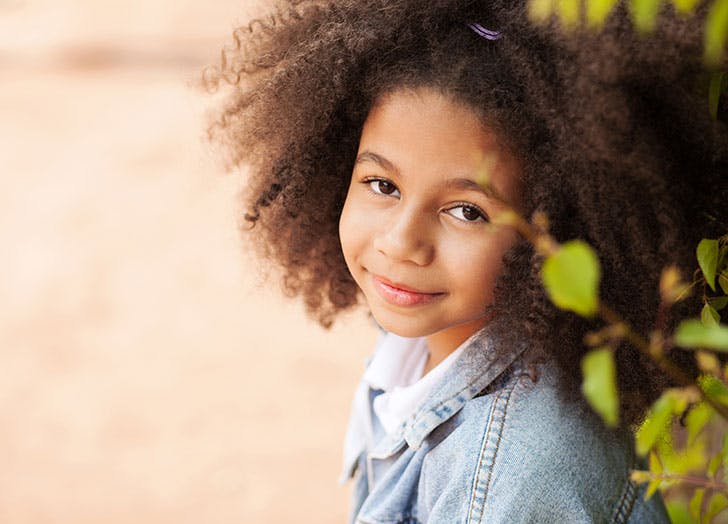 Outdoor portrait of a beautiful little girl