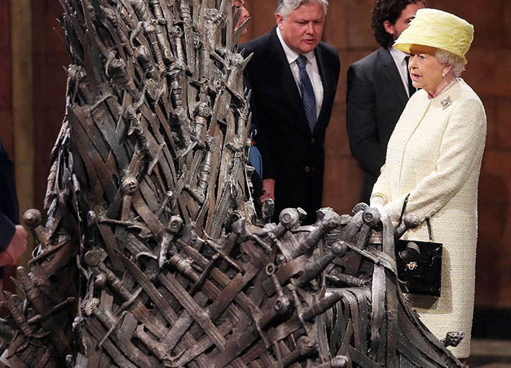 Queen Elizabeth II views the Iron Throne on the set of Game of Thrones