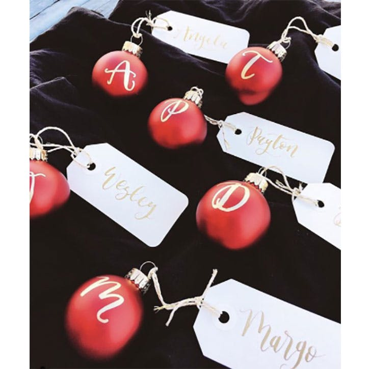 Red Christmas baubles used for place cards
