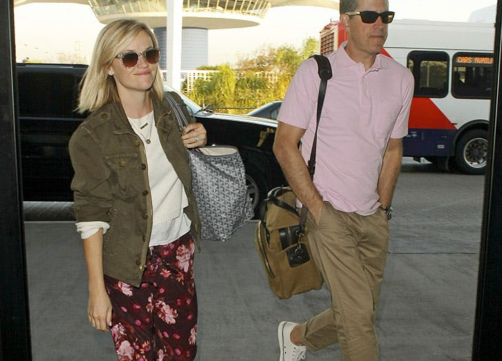 Reese Witherspoon and Jim Toth are seen arriving at LAX airport