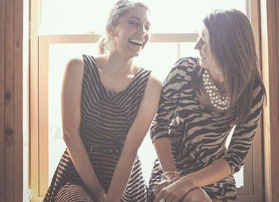 Sisters laughing together 400