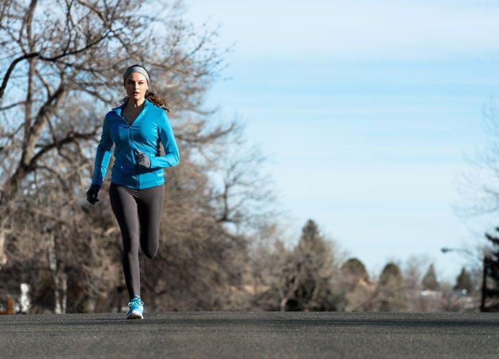 Woman Running Outside in Winter