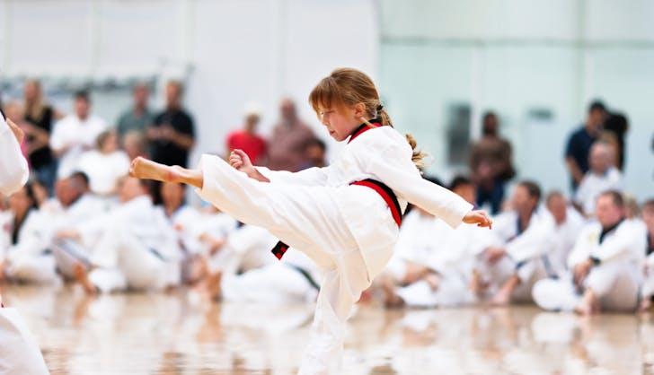 child learning judo