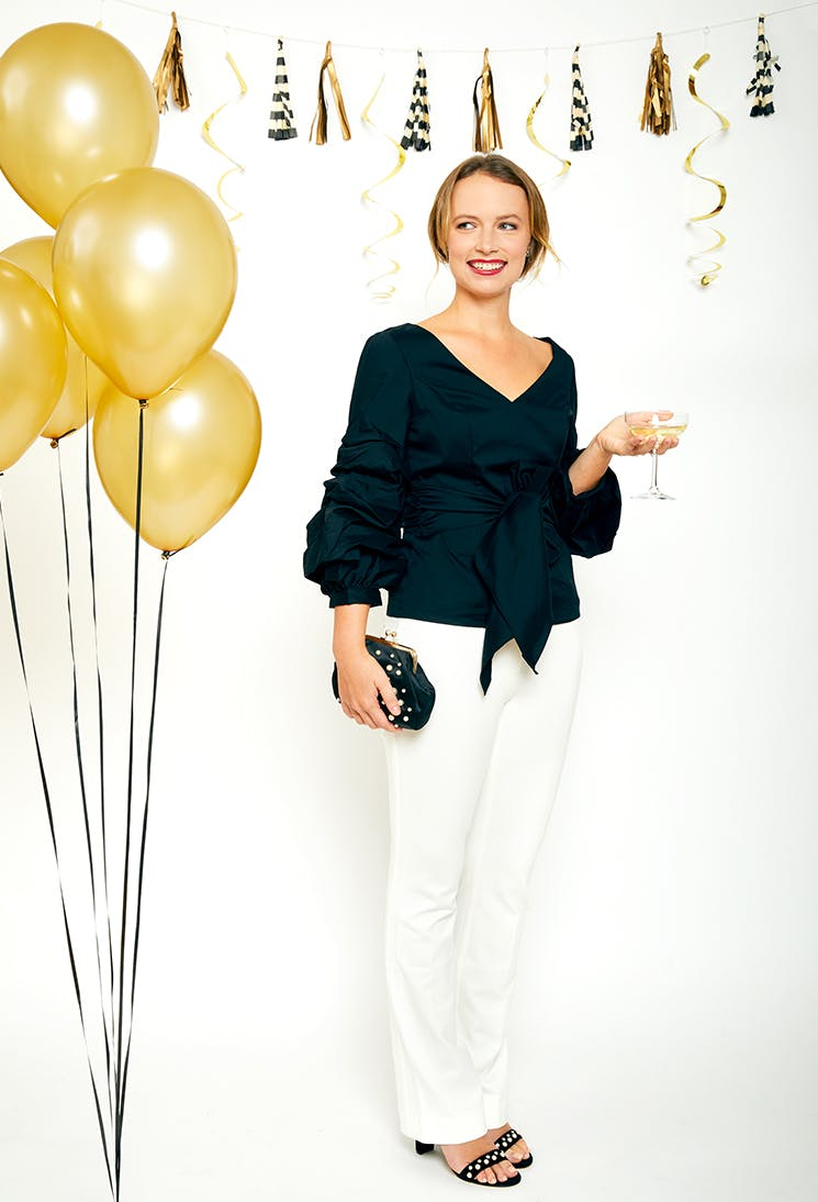 grace whbm black top and white pants