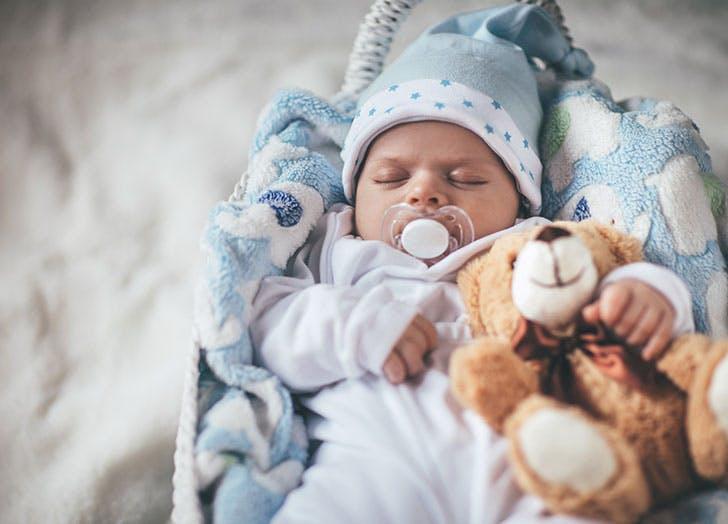 Baby asleep with teddy bear
