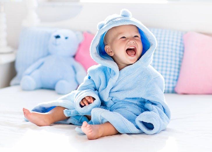 Baby boy in bathrobe after bath 1