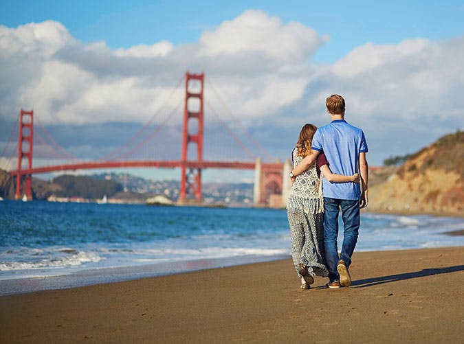 Couple having a date on Baker beach in San Francisco  California  USA