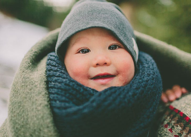 Cute baby all wrapped up in winter clothes
