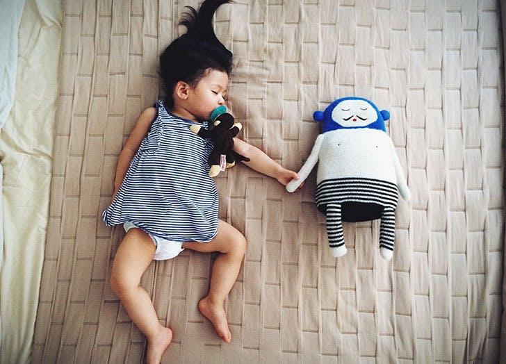 Cute baby girl asleep with her stuffed animal