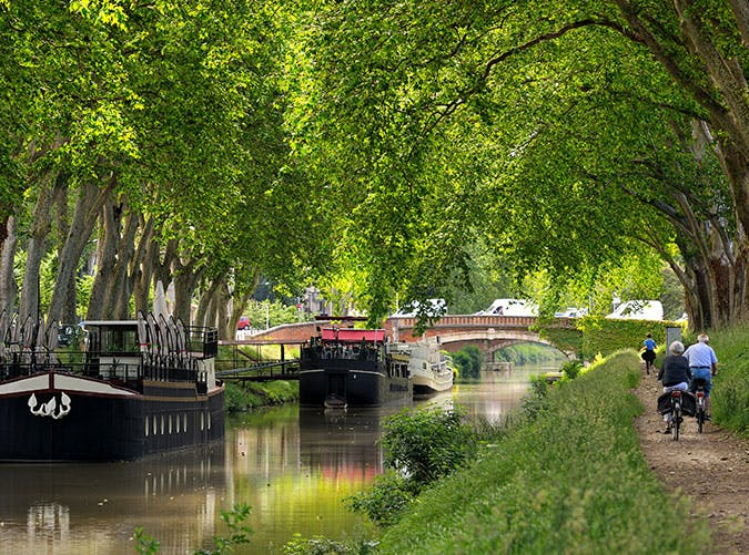 Cycling along the canal of midi in Toulouse  France