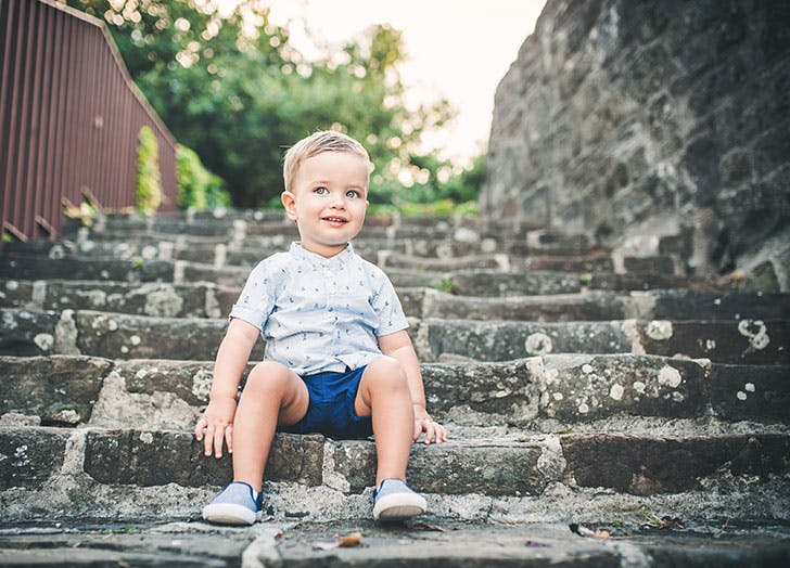 Danish boy sitting outside on steps