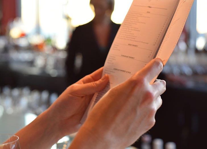 Holding a restaurant menu