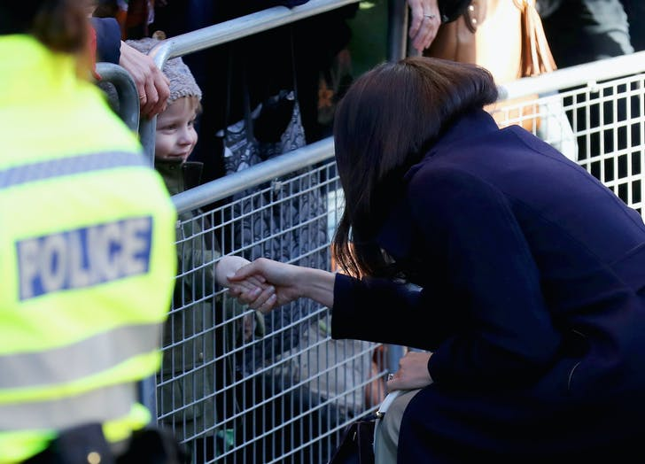 Meghan Markle first public outing shaking hands child