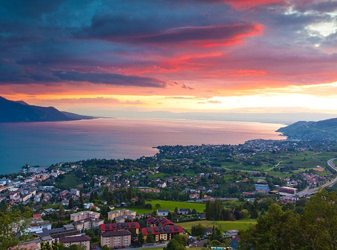 Sunrise over the city of and Lausanne in Switzerland