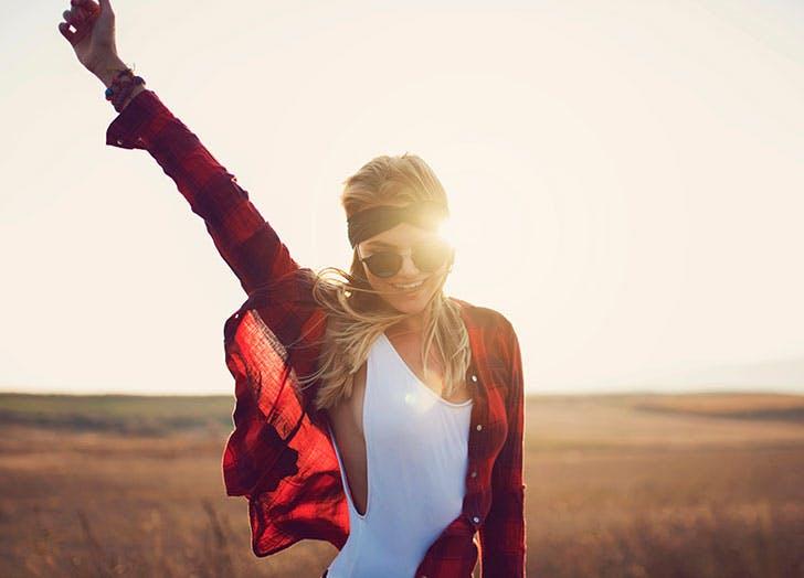 Woman in field wearing sunglasses