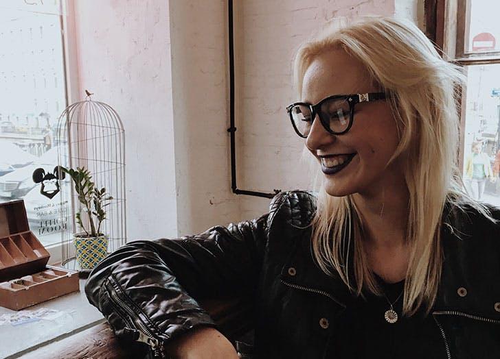 Woman wearing glasses dressed in black