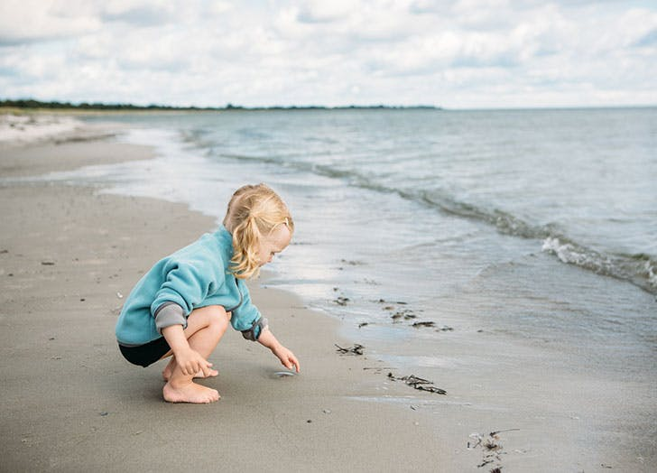Young Danish girl playing on the beach